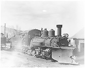Pilot-end, engineer's-side view of RGS K-27 #455 with snow plow and new cab at the Ridgway sand house.<br /> RGS  Ridgway, CO  post 3/1947