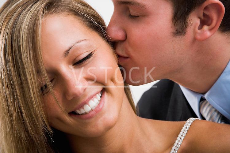 Caylee Sharp Jessee Unsicker horizontal man kissing woman lifestyle male female couple 20 twenty twenties white Caucasian companionship relationship boyfriend girlfriend dating marriage love romance romantic affection affectionate kiss