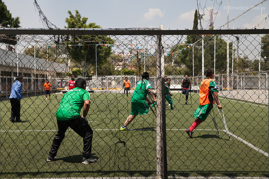 "Players from Guerreros Aztecas during a training session with the team in Mexico City, Mexico on August 23, 2014. Guerreros Aztecas (""Aztec Warriors"") is Mexico City's first amputee football team. Founded in July 2013 by five volunteers, they now have 23 players, seven of them have made the national team's shortlist to represent Mexico at this year's Amputee Soccer World Cup in Sinaloa this December. The team trains twice a week for weekend games with other teams. No prostheses are used, so field players missing a lower extremity can only play using crutches. Those missing an upper extremity play as goalkeepers. The teams play six per side with unlimited substitutions. Each half lasts 25 minutes. The causes of the amputations range from accidents to medical interventions – none of which have stopped the Guerreros Aztecas from continuing to play. The players' age, backgrounds and professions cover the full sweep of Mexican society, and they are united by the will to keep their heads held high in a country where discrimination against the disabled remains widespread. (Photo by Bénédicte Desrus)"