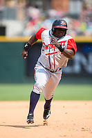 Ronnier Mustelier (25) of the Gwinnett Braves hustles towards third base against the Charlotte Knights at BB&T BallPark on May 22, 2016 in Charlotte, North Carolina.  The Knights defeated the Braves 9-8 in 11 innings.  (Brian Westerholt/Four Seam Images)