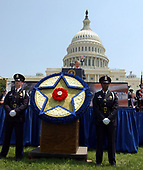 Washington, DC - May 15, 2004 -- United States President George W. Bush makes remarks at the Annual Peace Officers' Memorial Service on the West Lawn of the United States Capitol in Washington, D.C. on May 15, 2004.  The service, sponsored by the Fraternal Order of Police (FOP), is held annually on May 15 to honor those who gave their lives during the previous year and to honor their families.  The service remembers the sacrifice of the more than 15,000 officers who have been killed in the line of duty since 1794.<br /> Credit: Ron Sachs / CNP<br /> (RESTRICTION: NO New York or New Jersey Newspapers or newspapers within a 75 mile radius of New York City)