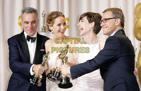 Daniel Day Lewis, Jennifer Lawrence, Anne Hathaway, Christoph Waltz.85th Annual Academy Awards held at the Dolby Theatre at Hollywood & Highland Center, Hollywood, California, USA..February 24th, 2013.pressroom oscars half length black tuxedo bow tie beard facial hair white smiling laughing  shirt award trophy trophies winner winners white pink pale strapless dress trophies winners profile glasses .CAP/ADM.©AdMedia/Capital Pictures.