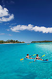FRENCH POLYNESIA, Moorea. Tourists paddling in the water.