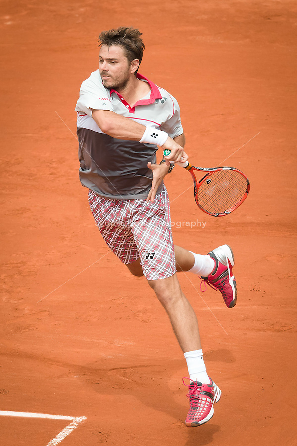 May 24, 2015: Stan Wawrinka (SUI) in action in a 1st round match against Marsel Ilhan (TUR) on day one of the 2015 French Open tennis tournament at Roland Garros in Paris, France. Wawrinka won 63 62 63. Sydney Low/AsteriskImages