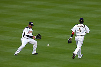 22 March 2009: #1 Kosuke Fukudome of Japan fails to catch a fly ball in front of #6 Hiroyuki Nakajima during the 2009 World Baseball Classic semifinal game at Dodger Stadium in Los Angeles, California, USA. Japan wins 9-4 over Team USA.