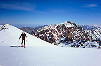 Reaching Ras Ouanoukrim (4088 m) ith Toubkal (4167 m) in the background, High Atlas, Morocco, 2017