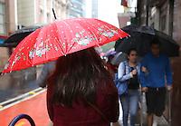 PORTO ALEGRE, RS, 24.07.2014 - CLIMA TEMPO - PORTO ALEGRE - Chuva com intensidade variada permanece o dia inteiro em Porto Alegre, nesta quinta-feira, 24. (Foto: Pedro H. Tesch / Brazil Photo Press).