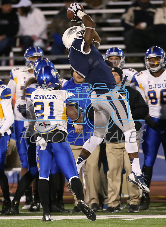 Nevada's Brandon Wimberly tries to come up with the ball as San Jose State's Bene Benwikere watches in an NCAA college football game in Reno, Nev., on Saturday, Nov. 16, 2013. (AP Photo/Cathleen Allison)
