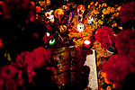 A child's grave is covered with treats and toys on All Souls Day in a cemetery in San Felipe del Agua, a small town outside of Oaxaca, Mexico Nov. 2, 2010.