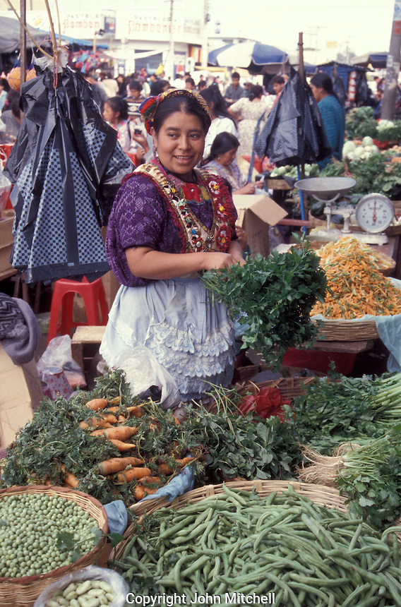 Maya woman selling produce in the market in Quetzaltenango, Guatemala