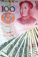 A photo showing bills of Chinese RMB, US dollars, and euros in Shanghai, China. Recent rumors of China's plans to diversify its estimated USD 1 trillion (euro 833 billion) foreign reserves away from U.S. treasuries and into currencies such as the euro have fueled speculations and helped to push the dollar sharply lower in currency markets this week..