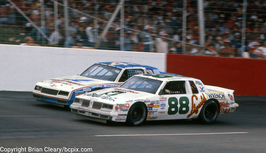 The #88 Oldsmobile of Buddy Baker and the #44 Chevrolet of Terry Labonte race side by side during  the Southern 500 at Darlington Raceway in Darlington SC on September 1, 1985. (Photo by Brian Cleary/www.bcpix.com)