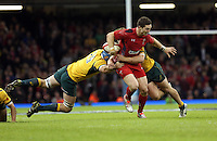 Pictured: George North of Wales (C) is brought down by James Hornwill (L) and another Australia player. Saturday 08 November 2014<br />