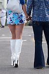 Goodwood Festival of Speed. Goodwood Sussex UK. Mini skirt white high heel boots.