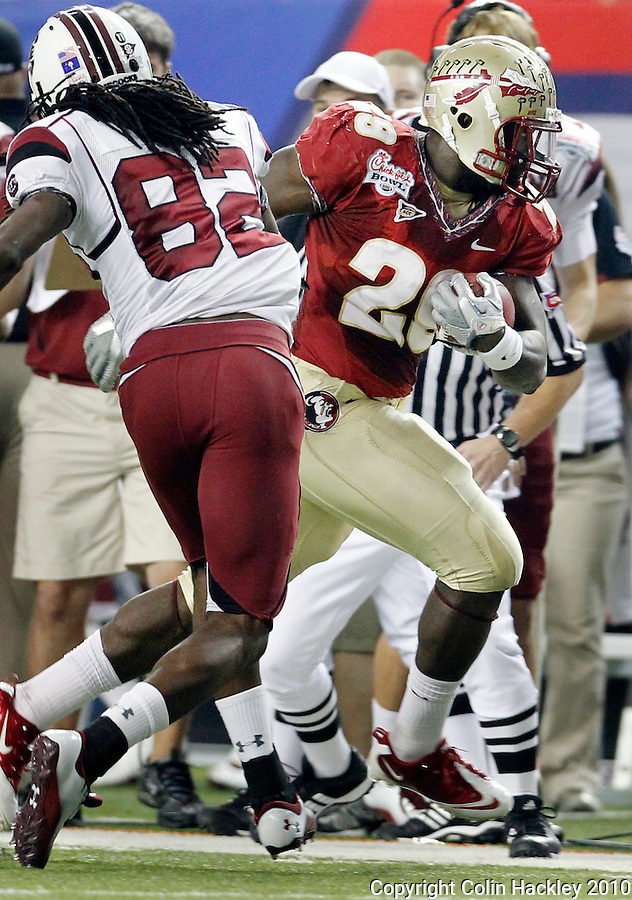 ATLANTA, AG 12/31/10-FSU-SC FB10 CH-Florida State's Kendall Smith runs after intercepting a South Carolina pass as D.L. Moore pursues during first half action Friday at the Chick-fil-A Bowl in Atlanta..COLIN HACKLEY PHOTO