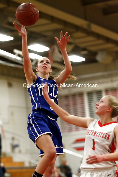 Winsted, CT- 05 January 2015-010515CM09 Lewis Mills' Ailene Berry (3) goes for two against Northwestern's  Kelsi Hodgkin during their Berkshire League matchup in Winsted on Monday.   Christopher Massa Republican-American