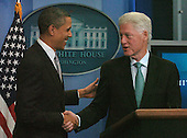 United States President Barack Obama and former US President William Clinton shake hands as they meet reporters in the White House Press Room in Washington, DC Friday 10 December 2010. Clinton endorsed the tax compromise Obama made with Republican congressional leaders..Credit: Bill Auth / Pool via CNP