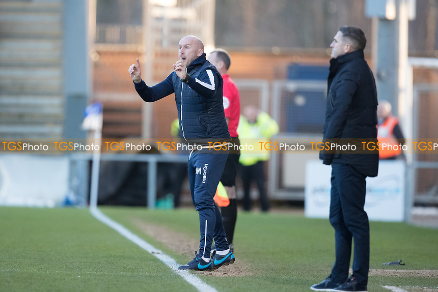 John McGreal, Head Coach of Colchester United passes on instruction from the touch line during Colchester United vs Plymouth Argyle, Sky Bet EFL League 2 Football at the JobServe Community Stadium on 8th February 2020