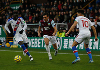 30th November 2019; Turf Moor, Burnley, Lanchashire, England; English Premier League Football, Burnley versus Crystal Palace; Jack Cork of Burnley runs at Cheikhou Kouyate and Andros Townsend of Crystal Palace - Strictly Editorial Use Only. No use with unauthorized audio, video, data, fixture lists, club/league logos or 'live' services. Online in-match use limited to 120 images, no video emulation. No use in betting, games or single club/league/player publications
