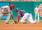 11 September 2016: Philadelphia Phillies infielder Freddy Galvis attempts a tag on Washington Nationals outfielder Trea Turner  in the third inning at Nationals Park in Washington, DC. The Nationals edged out the Phillies 3-2 to take the rubber match of their 3-game series. Mandatory Credit: Ed Wolfstein Photo *** RAW (NEF) Image File Available ***