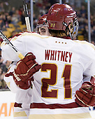 Barry Almeida (BC - 9) and Steven Whitney (BC - 21) celebrate Whitney's goal. - The Boston College Eagles defeated the Providence College Friars 4-2 in their Hockey East semi-final on Friday, March 16, 2012, at TD Garden in Boston, Massachusetts.