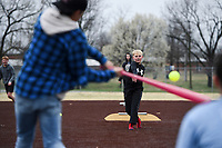 Parker Brewer, 11, of Bentonville throws a pitch, Monday, March 16, 2020 during a baseball game at the Memorial Park ball field in Bentonville. Check out nwaonline.com/200317Daily/ for today's photo gallery.<br /> (NWA Democrat-Gazette/Charlie Kaijo)