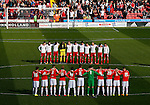 Players take part in a minutes silence for the victims of the Belgium terrorist atrocities during the Sky Bet League One match at Bramall Lane Stadium. Photo credit should read: Simon Bellis/Sportimage