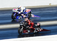 Nov. 10, 2012; Pomona, CA, USA: NHRA pro stock motorcycle rider Matt Smith (near lane) races alongside Hector Arana Jr during qualifying for the Auto Club Finals at at Auto Club Raceway at Pomona. Mandatory Credit: Mark J. Rebilas-