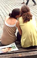 Friends age 20 telling secrets.  Poznan Poland