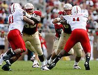 TALLAHASSEE, FL 10/31/09-FSU-NCST FB09 CH58-Florida State offensive linemen Rodney Hudson, left, and Andrew Datko block N.C. State's Dwayne Maddox, left, and Audi Augustin   during first half action Saturday at Doak Campbell Stadium in Tallahassee. .COLIN HACKLEY PHOTO