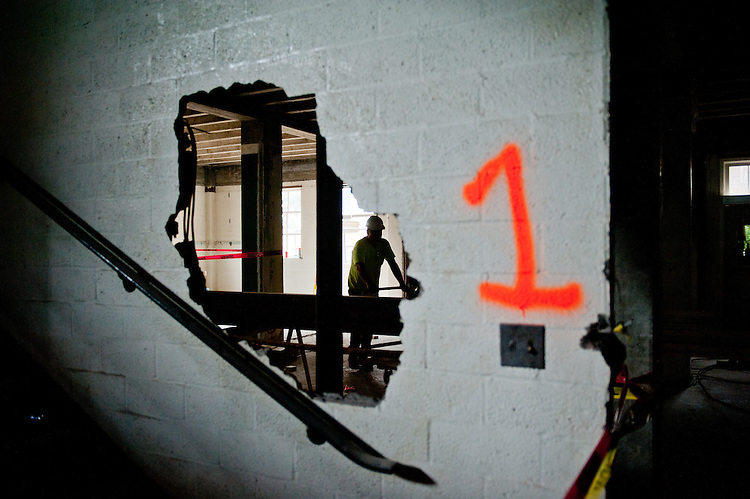 A demolition worker walks through Ohio University's Old Baker Center during its reconstruction on July 13, 2012 in Athens, Ohio.