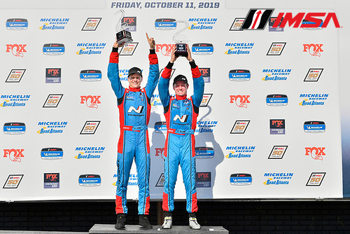 #98 Byan Herta Autosport W Curb-Agajanian Hyundai Veloster N TCR, TCR: Mark Wilkins, Michael Lewis celebrate the win on the podium with trophy