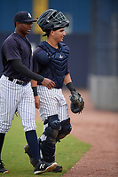 New York Yankees pitcher Adonis De La Cruz and catcher Mickey Gasper (16) during a Minor League Spring Training game against the Atlanta Braves on March 12, 2019 at New York Yankees Minor League Complex in Tampa, Florida.  (Mike Janes/Four Seam Images)