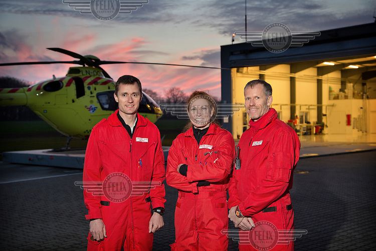 Denmarks first  air ambulance serivce, operated by Norwegian Air Ambulance. The crew is pilot Jan Nielsen(right) , HEMS paramedic Lars Greve-Wilms and doctor Rikke Helene Rasmussen. <br /> <br /> The crew operate an Airbus EC-135 out of the Ringsted base, one of three bases in Denmark.