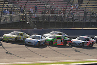 Oct. 10, 2009; Fontana, CA, USA; NASCAR Nationwide Series drivers Carl Edwards (60), Brad Keselowski (88) and David Ragan (6) get tangled during a restart during the Copart 300 at Auto Club Speedway. Mandatory Credit: Mark J. Rebilas-