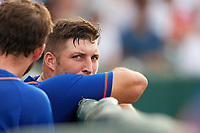 St. Lucie Mets left fielder Tim Tebow (15) talks with teammates in the dugout during a game against the Florida Fire Frogs on July 23, 2017 at Osceola County Stadium in Kissimmee, Florida.  St. Lucie defeated Florida 3-2.  (Mike Janes/Four Seam Images)