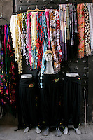 Scarves and salwar kameez trousers at the Hasan Pasha Han, Diyarbakir, southeastern Turkey