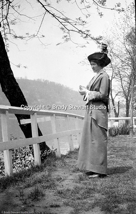 Highland Park: Sarah Stewart taking a break from a stroll through Highland Park with Brady Stewart - 1912.  Allegheny River in the background.  During this time, Brady Stewart lived 5801 Wellesley Avenue in Highland Park not far from the park entrance.