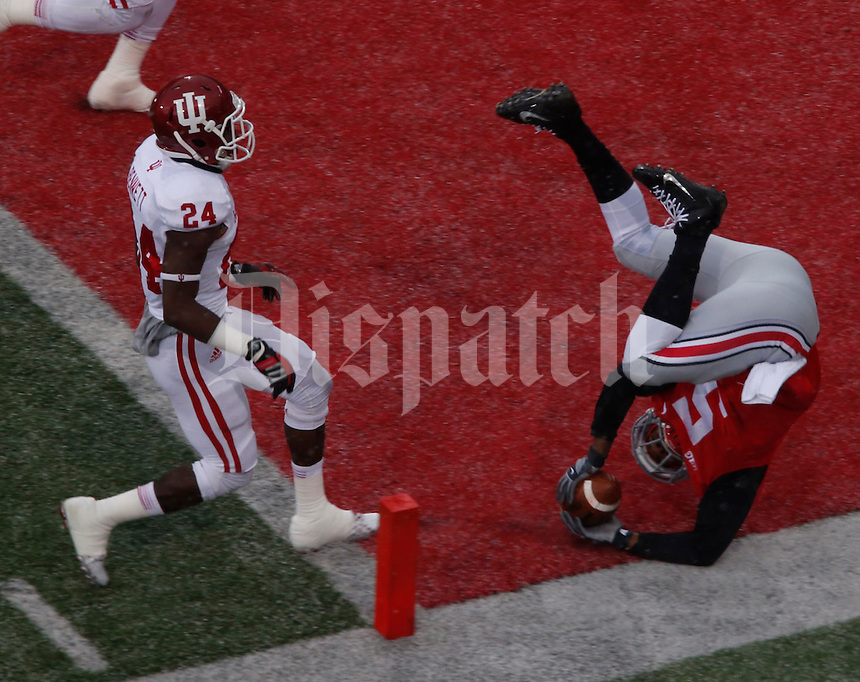 OhioState Buckeye Ohio State Buckeyes quarterback Braxton Miller (5) tumbles into end zone for aTD Indiana Hoosiers in the first quarter at Ohio State Stadium in Columbus  Nov. 23, 2013.