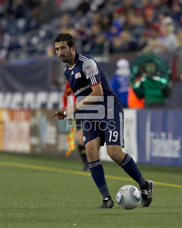 New England Revolution midfielder Monsef Zerka (19) passes the ball.  In a Major League Soccer (MLS) match, the Columbus Crew defeated the New England Revolution, 3-0, at Gillette Stadium on October 15, 2011.