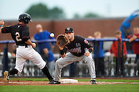 Wisconsin Timber Rattlers first baseman Alan Sharkey (18) waits for a throw as Bobby Boyd (2) gets back to first during the first game of a doubleheader against the Quad Cities River Bandits on August 19, 2015 at Modern Woodmen Park in Davenport, Iowa.  Quad Cities defeated Wisconsin 3-2.  (Mike Janes/Four Seam Images)