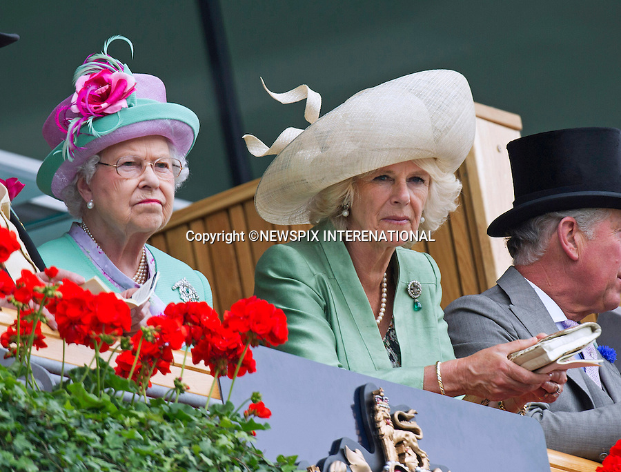QUEEN, CAMILLA, DUCHESS OF CORNWALL AND PRINCE CHARLES<br /> observe the horses in the parade ring before the race at Royal Ascot 2013, Ascot Racecourse, Ascot_19/06/2013<br /> Mandatory Credit Photo: &copy;Francis Dias/NEWSPIX INTERNATIONAL<br /> <br /> **ALL FEES PAYABLE TO: &quot;NEWSPIX INTERNATIONAL&quot;**<br /> <br /> IMMEDIATE CONFIRMATION OF USAGE REQUIRED:<br /> Newspix International, 31 Chinnery Hill, Bishop's Stortford, ENGLAND CM23 3PS<br /> Tel:+441279 324672  ; Fax: +441279656877<br /> Mobile:  07775681153<br /> e-mail: info@newspixinternational.co.uk