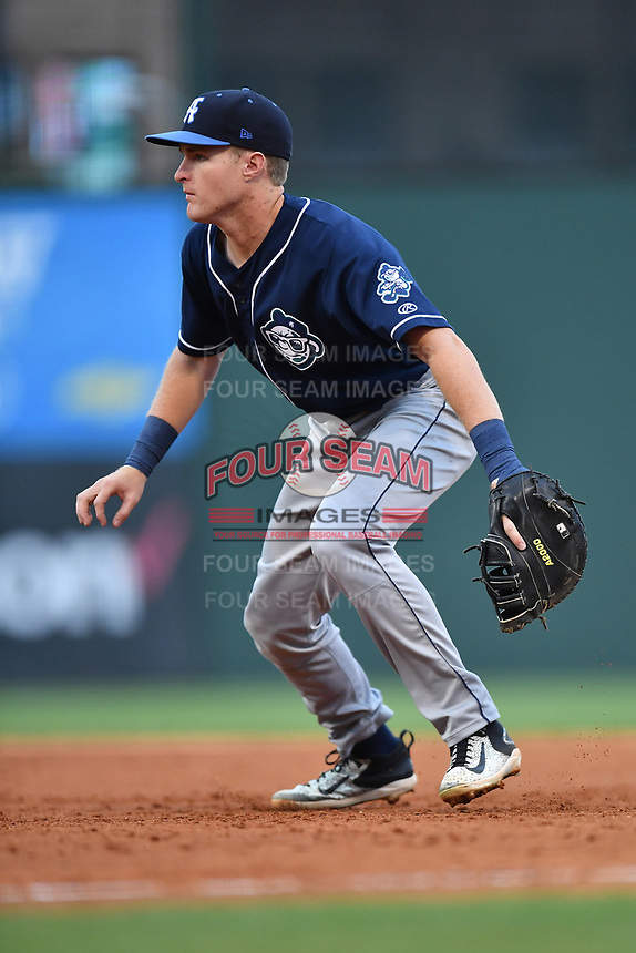 First baseman Tyler Kevin (23) of Asheville Tourists plays defense in a game against the Greenville Drive on Wednesday, May 3, 2017, at Fluor Field at the West End in Greenville, South Carolina. Greenville won, 8-0. (Tom Priddy/Four Seam Images)