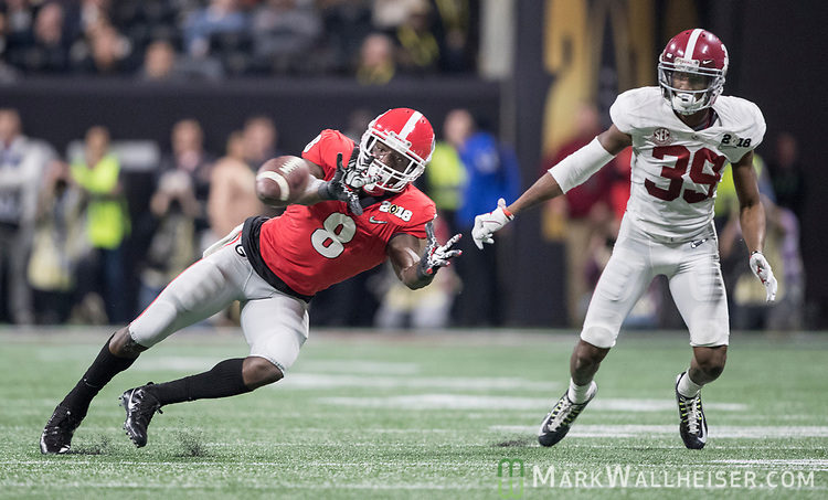 Georgia Bulldogs wide receiver Riley Ridley (8) makes a catch in front of Alabama Crimson Tide defensive back Levi Wallace (39) in the second quarter of the NCAA College Football Playoff National Championship at Mercedes-Benz Stadium on January 8, 2018 in Atlanta. Photo by Mark Wallheiser/UPI
