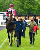 Winner of The Sorvio Insurance Brokers Maiden Stakes Mankayan ridden by Kieran Shoemark and trained by Charlie Fellows  is led into the Winners enclosure during Evening Racing at Salisbury Racecourse on 11th June 2019