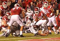 NWA Democrat-Gazette/MICHAEL WOODS • Mississippi State quarterback Dak Prescott dives through the Arkansas defense to score a touchdown n the 4th quarter of Saturday nights game at Razorback Stadium November 21, 2015.