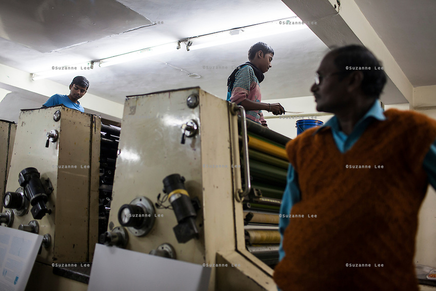 Workers prepare to print the current issue of Khabar Lahariya weekly newspaper, after receiving the files from the newspaper's Chitrakoot office, in Allahabad, Uttar Pradesh, India on 06 December 2012. Photo by Suzanne Lee / Marie Claire France
