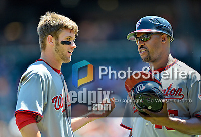 25 July 2012: Washington Nationals outfielder Bryce Harper chats with third base coach Bo Porter during a game against the New York Mets at Citi Field in Flushing, NY. The Nationals defeated the Mets 5-2 to sweep their 3-game series. Mandatory Credit: Ed Wolfstein Photo