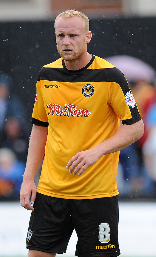 Newport County's Lee Minshull in action during todays match  <br /> <br /> Photographer Ashley Crowden/CameraSport<br /> <br /> Football - The Football League Sky Bet League Two - Newport County AFC v Wycombe Wanderers - Saturday 9th August 2014 - Rodney Parade - Newport<br /> <br /> &copy; CameraSport - 43 Linden Ave. Countesthorpe. Leicester. England. LE8 5PG - Tel: +44 (0) 116 277 4147 - admin@camerasport.com - www.camerasport.com