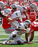 Ohio State Buckeyes linebacker Jared Drake, left, Ohio State Buckeyes linebacker Pete Werner, center, and Ohio State Buckeyes safety Isaiah Pryor, bottom, bring down UNLV Rebels punt returner Jericho Flowers during the second quarter of a NCAA college football game between the Ohio State Buckeyes and the UNLV Rebels on Saturday, September 23, 2017 at Ohio Stadium in Columbus, Ohio. [Joshua A. Bickel/Dispatch]